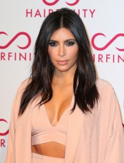 Khloe-and-Kim-Kardashian---Hairfinity-UK-Launch-Party-13.md.jpg
