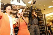 Kim and Khloe Kardashian Promote The Kardashian Kollection 12